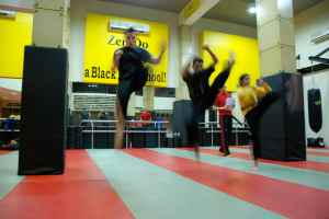 Doing jumping front kicks