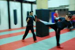 Thomas doing and roundhouse kick