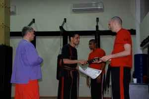 Hussain receiving his Black Belt