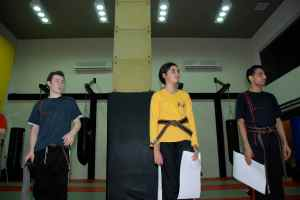 Thomas, Yasmeen and Hussain with their Black Belt certificates
