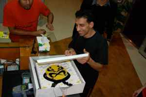 Hussain getting a surprise celebration cake from his wife