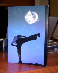 The Eid card I sent out with a photo of me doing a side kick.