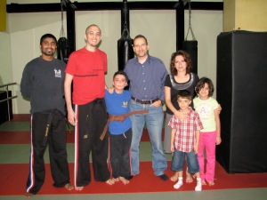 From left, Sensei Vinod Joseph, me, Junaid with his new Brown Belt, dad Amr, mother Areez, younger brother Yazin, and grading supporter Selma.